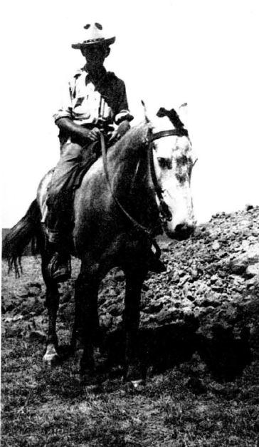 Carlyle Smith on horseback